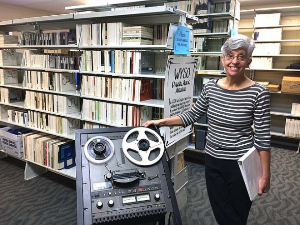 WYSO General Manager Neenah Ellis stood in front of more than 50 years of radio station archives, including more than 5,000 recordings on a variety of media. Last month WYSO released nearly 200 digital recordings online after a six-year project to convert and categorize them. (Photo by Megan Bachman)