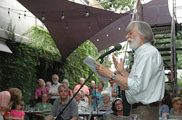 Local author Bill Felker read some of his observations of the natural world during the opening of the 25/25 landscape art exhibit at the Winds Cafe on Sunday, July 12. The art, to benefit Tecumseh Land Trust, will show through Sept. 6. (photo by Dylan Taylor-Lehman)