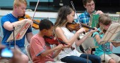 Students and teachers alike perform last Friday, July 10, in the Yellow Springs Summer Music Camp orchestra. Pictured above are, from left, teacher Alex Moore, Antonio Chaiten, Sophie Hannes, Sean Adams and Adeline McKay. (Photos by Matt Minde)