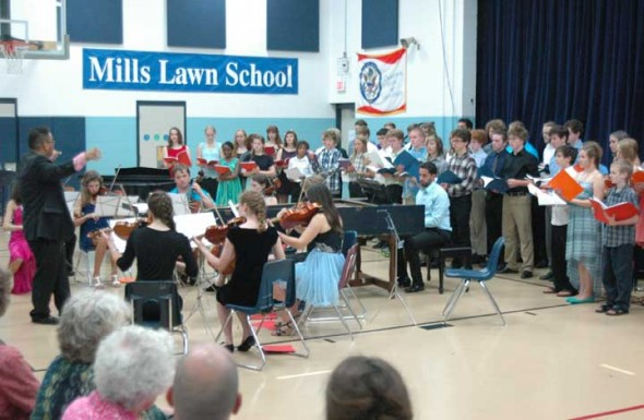 Campers and staff from Friends Music Camp present their annual Yellow Springs concert this Saturday, July 25, at 7:30 at Mills Lawn gym. Last year's concern is shown above.