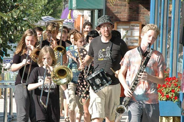 "The Friends Music Camp Street Band marched a quick downtown loop Saturday afternoon to announce their concert that evening, ""Musicians for Justice and Peace,"" which benefited Glen Helen. (Photo by Matt Minde)"