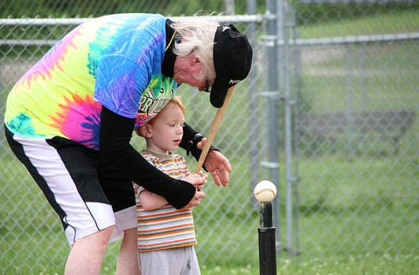 The Perry League T-ball gang has two weeks left of play this summer — this Friday, July 31 at 6:30 p.m. and Friday, Aug. 7, the annual grande finale event, both at Gaunt Park. Shown here at a recent game are Coach Jimmy and Corbin Hyatt. (Photo by Suzanne Szempruch)