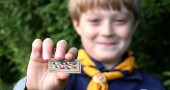 "Cub Scout Bobby Wyatt holds an ""Inclusive Scouting Award"" distributed by the Scouts for Equality. The symbolic badge signals a scout is tolerant and inclusive. (Submitted photo by Lake Miller)"