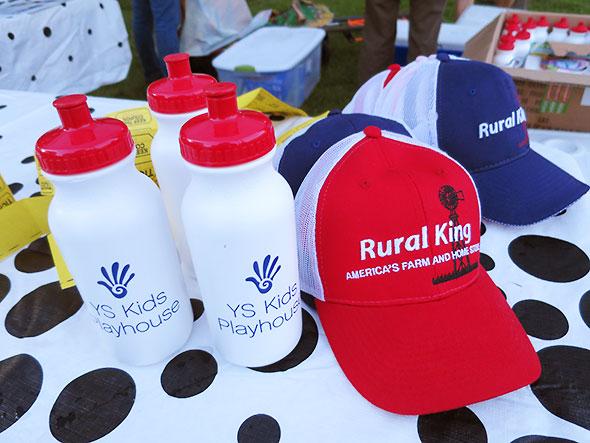 Rural King caps and YSKP water bottles