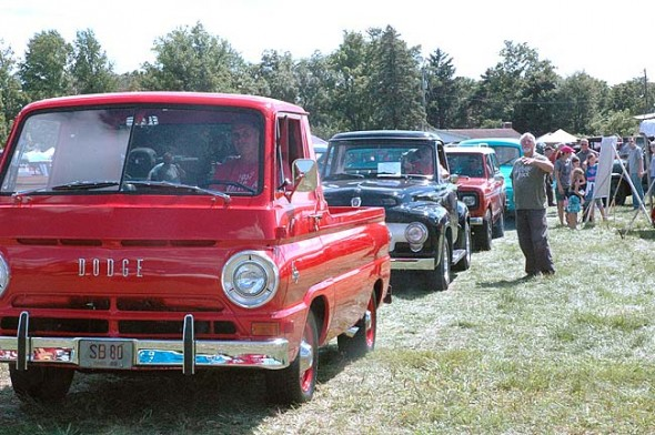 Organizer and publisher Patrick Ertel bids farewell to a few of the vintage trucks at the 14th annual vintage truck show last Saturday, Aug. 1, at Young's Dairy. His magazine Vintage Truck hosts the event, which draws truck enthusiasts from across the country. Over 150 trucks were exhibited, from antique firetrucks to pickups to military transports. (Photo by Dylan Taylor-Lehman)