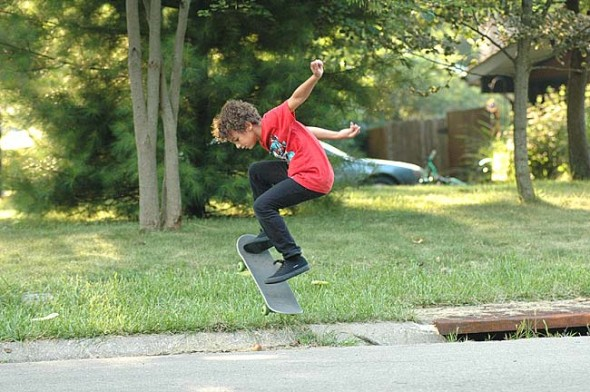 Derek Reed, 8, practiced ollies near his home on West South College Street this week.  (Photo by Lauren Heaton)