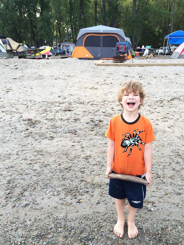 Boy finds a big flat rock