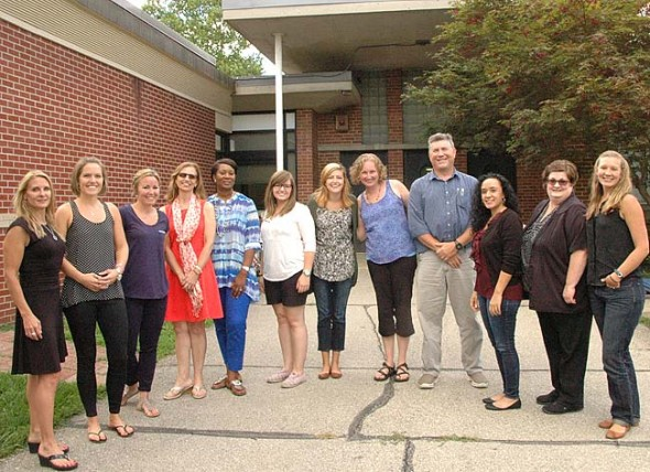 Teacher's dozen Twelve new teachers and administrators gathered at an orientation at Mills Lawn last week. They are, from left, Donna First, Kristin McNeely, Kate Lohmeyer, Jackie Pohl, Lynne Wooten-Mitchell, Maggie DeMarse, Chasity Miller, Jen Clark, Brian Knostman, Ettamarie Valdez, Jodi Black and Becca Eastman. Not pictured is Shannon Wilson. (Photo by Audrey Hackett)