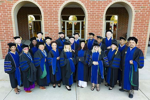 Shown above are 20 members of Antioch University's Ph.D. in Leadership and Change Class of 2015, shown at AU Midwest following their Aug. 1 commencement. Altogether, the group included 23 graduates from 14 states and three countries. (Submitted Photo by Andy Snow )