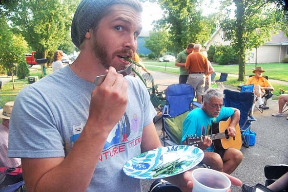 Toby Cromer ate his greens at the Kingsfield Court block party.