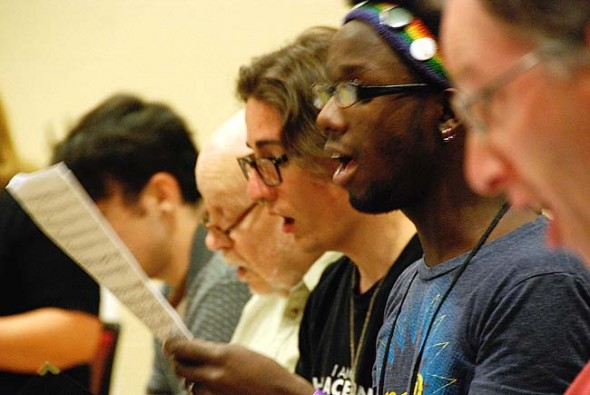 The World House Choir is rehearsing Paul Winter's Missa Gaia for a local performance Friday and Saturday, Sept. 11 and 12, at 7 p.m. at the Antioch College Amphitheatre. Above, from left are basses Lucas Bautista (obscured), Ron Siemer, Frank Fortino, Nick Daily and David Seitz. (Submitted Photo by Liz Mersky)