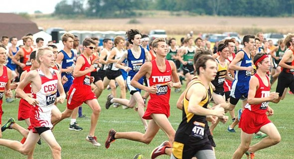 Hundreds of runners compete in a 5K during last week's Friendship Invitational, held at Cedarville University. Yellow Springs High School's Kaden Boutis feels the wind in his hair, running with fellow Bulldogs Zach Brintlinger-Conn, left, and Levi Brown.  (photo by Dylan Taylor-Lehman)
