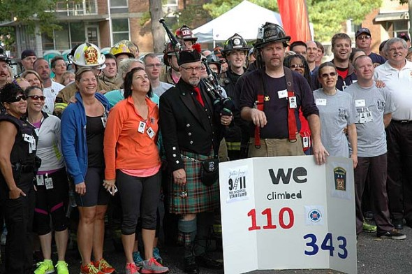 Participants of last year's 9/11 Stair Climb posed for a photographer who was shooting from atop an extended firetruck ladder. About 90 people from the community and area emergency response agencies participated. (Photo by Lauren Heaton)