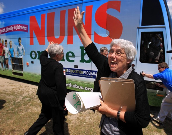 """Sister Mary Wendlen, one of four nuns on a 2012 """"Nuns on the Bus"""" tour, waves goodbye to supporters in Fox Lake, Ill., in 2012."""