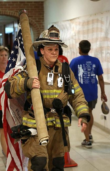Aimee Maychack carried a flag through main building during the climb. (Submitted photo by Patrick O'Reilly)
