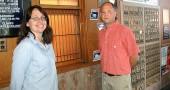 Postmaster Ken Hensley joined the Yellow Springs post office this summer, working alongside longtime local postal clerk Molly Panstingel. (Photo by Lauren Heaton)