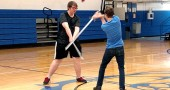 "Duard Headley (Macbeth) and Nicolas ""Bear"" Wright (Macduff) vie for the throne in YSHS's production of ""Macbeth."" The actors engaged in professional stage combat training and Shakespeare reading workshops to immerse themselves more fully in the performance. ""'Macbeth' is not meant to be read; it's meant to be played,"" said the play's director Lorrie Sparrow-Knapp. 'The Scottish play' opens Oct. 30 at 8 p.m. at Mills Lawn Elementary School gym. (Photo by Dylan Taylor-Lehman)"
