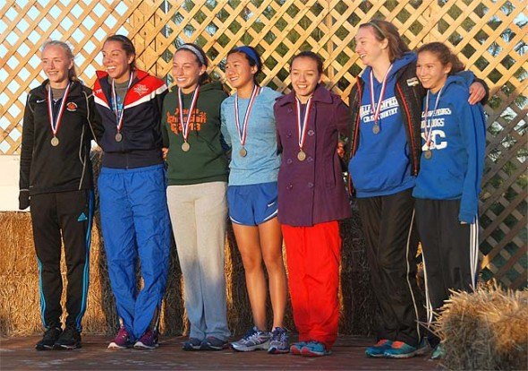 Yellow Springs High School cross-country runners Charlotte Walkey (second from right) and Jude Meekin (far right) earned all-conference first team honors at the Metro Buckeye Championships on Oct. 16. Walkey ran her best 5K time of the season at the championship, as did many of her teammates. The Bulldogs will run in the district meet on Saturday, Oct. 24, at the Miami Valley Career Tech Center.  (Submitted photo)