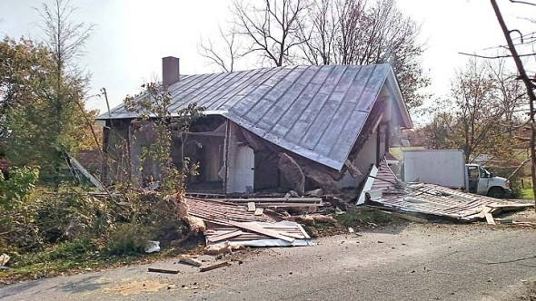 Looking south at the caved roof of the same house.