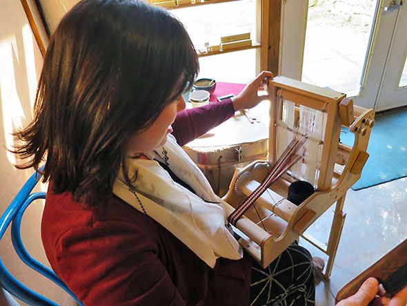 Jodie Erickson Gollings of Red Hen Designs working on a strap at the loom