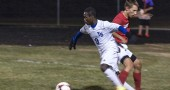 Levi Jackson won the ball from a Twin Valley South player on the way to the Bulldogs' 7–0 home victory over the West Alexandria team in the first round of Div. III sectional tournament play on Wednesday, Oct. 21. (photo by Aaron Zaremsky)