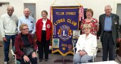 "Members of the Yellow Springs Lions Club pose for a photo at the group's farewell gala at the Senior Center on Nov. 4. The group is disbanding after 64 years of service to the community. The Lions' activities included everything from repaving YSHS tennis courts to activities benefiting eyesight-related causes. ""The whole concept is that we serve,"" said Yellow Springs Lion Griff Johnson. ""Any money we made was put right back out into the community."" (photo by Dylan Taylor-Lehman)"