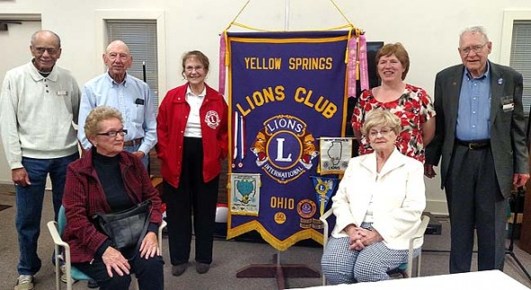 """Members of the Yellow Springs Lions Club pose for a photo at the group's farewell gala at the Senior Center on Nov. 4. The group is disbanding after 64 years of service to the community. The Lions' activities included everything from repaving YSHS tennis courts to activities benefiting eyesight-related causes. """"The whole concept is that we serve,"""" said Yellow Springs Lion Griff Johnson. """"Any money we made was put right back out into the community."""" (photo by Dylan Taylor-Lehman)"""
