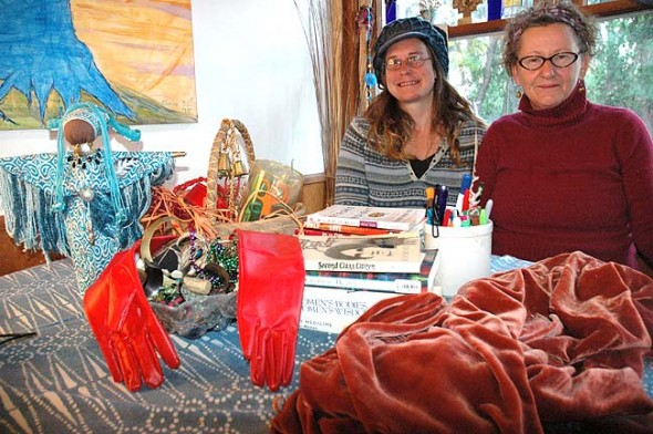 Lara Bauer, left, and Cathy Paige are inviting women to explore the emotions of guilt, shame and resentment through twice-monthly workshops involving the creation of wearable art. The next workshop will be held on Sunday, Nov. 29, from 2 to 4 p.m. The workshops will continue through December, January and February, and will culminate in a fashion show displaying particpants' pieces: the Cloak of Guilt, Mask of Resentment and Gloves of Shame. (photo by Diane Chiddister)