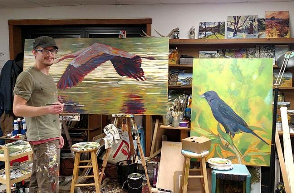 """Travis Tarbox Hotaling worked in his studio on a painting of a heron for his upcoming show """"Birding is Hard,"""" which will open at the Yellow Springs Brewery on Nov. 25, with a reception on Saturday, Nov. 28, from 3–5 p.m. His oversized paintings are a nod to the """"involved and elusive"""" practice of birding while portraying the complex and fascinating personalities of his subjects. (Photo by Dylan Taylor-Lehman)"""