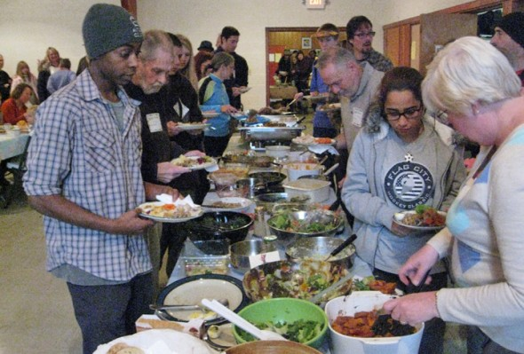 The annual Community Thanksgiving dinner takes place today from 2 to 4 p.m. at the First Presbyterian Church. Shown are a few of the several hundred people who came to last year's event.