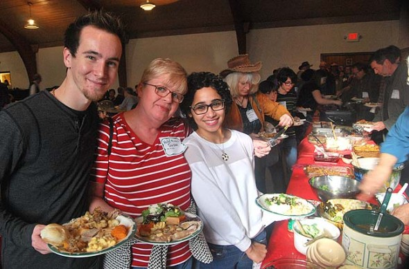David Hendrix, Susan Snow and Antioch College student Jamana Snow successfully navigated the buffet line, and had piled-high plates to prove it. Organizers estimate that at least 400 people attended this year's Community Thanksgiving dinner, the largest ever.