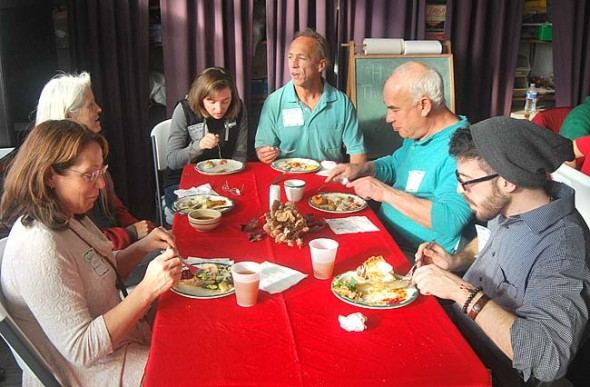 Ali Thomas, Charlotte Walkey, Rick Walkey and Dave Goodman, from top left in rear, were among those sharing food and conversation at the First Presbyterian Church, converted for an afternoon into a banquet hall for a potluck Thanksgiving feast.