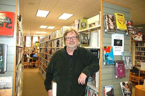 """Rajan Kose at one of his favorite spots in the village, the Yellow Springs Public Library, which he refers to as the local """"crown jewel."""" Kose moved to Yellow Springs two-and-a-half years ago, drawn by a lifelong friendship and the sense of peace and community he encountered here. (photo by Audrey Hackett)"""
