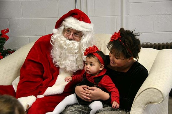 Alyssa and Aaliyah (who wasn't to sure about the man next to her) Worley got their picture taken with Santa last Saturday at the Annual Pancake Breakfast at the United Methodist Church. (Photo by Suzanne Szempruch)