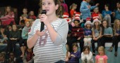 "Eliza Minde-Berman, aka Horton the Elephant, vows to protect Who, the ""tiniest planet in the sky,"" as well as hatch an egg against all odds and ridicule. Mills Lawn School's production of Seussical Jr. runs Friday and Saturday, Dec. 11 and 12, at 7 p.m., at Central State's Paul Robeson Auditorium. Tickets are limited as the cast of hundreds all have relatives. (photo by Carol Simmons)"