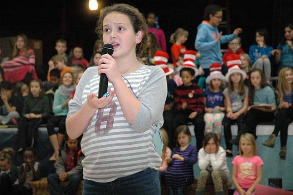 """Eliza Minde-Berman, aka Horton the Elephant, vows to protect Who, the """"tiniest planet in the sky,"""" as well as hatch an egg against all odds and ridicule. Mills Lawn School's production of Seussical Jr. runs  Friday and Saturday, Dec. 11 and 12, at 7 p.m., at Central State's Paul Robeson Auditorium. Tickets are limited as the cast of hundreds all have relatives.  (photo by Carol Simmons)"""