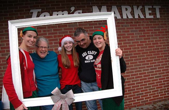 """Kate Anderson and Dan Carrigan posed for """"selfies with elfies"""" downtown last Sunday, with McKinney School students, from left, Jane Meister, Riley Duncan and Olivia Snoddy."""