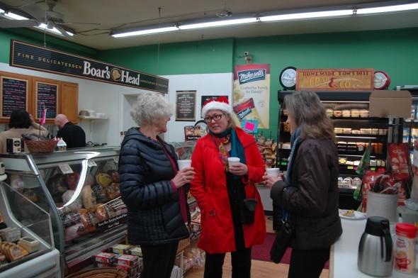 From left, Alice Robrish, Santa (aka Lori Askeland) and another cake-seeker enjoyed a Christmas morning chat.