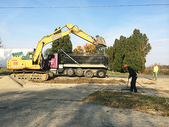 digging a ditch along Xenia Ave