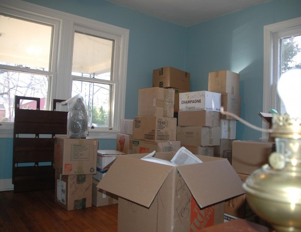 New home blues. Boxes awaiting unpacking, stashed in the new home's blue room. (Photo by Audrey Hackett)