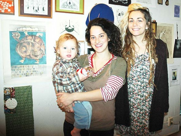 Villagers Ash Dasuqi, holding her son, Holden, and Pamela Williams will host an adult spelling bee fundraiser this Sunday, Jan. 10, at the Emporium to raise funds to send them to midwifery school