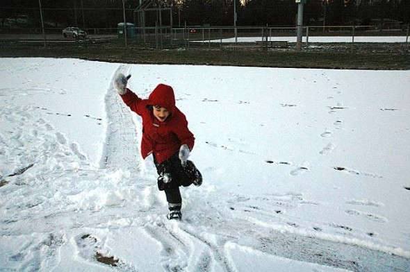 Unhindered by the snowless sledding hills, Mikey Trelawny-Cassity makes his own fun in Gaunt Park on the baseball diamond, which had retained a very enjoyable amount of snow.