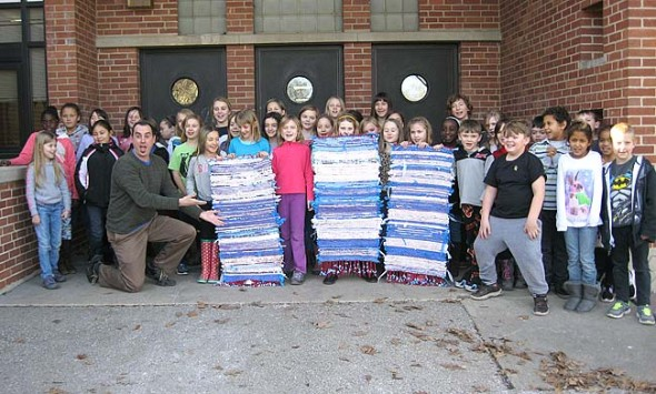 Mills Lawn School third graders proudly presented banners they'd woven from recycled materials to Principal Matt Housh. (Submitted photo courtesy of Mills Lawn School)