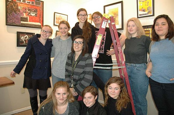 """An exhibit of """"YS in Color,"""" the work of YSHS students in the advanced art and AP art classes, opens with a reception at 6 p.m. this Friday, Jan. 22, at Village Artisans. Shown above are, top row left to right: Anna Mullin, Meredith Rowe, Callie Smith, Nicklas Wright, Kyra Siemer, Elesha Harney; Middle: Elisabeth Simon (teacher). Bottom row left to right: Olivia Chick, Holly Weir, Madeline Nielsen. Not pictured are artists Julian Roberts and Gracie Wilke. (Photo by Diane Chiddister)"""