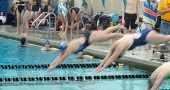 YSHS swimmer Madison Kellar dives into the frigid waters of competition on Jan. 23 at the Kenton Ridge Invitational in Dayton. The team's performance was laden with ranking finishes and no less than 27 personal bests. Kellar had a personal best in the 500 freestyle, swimming almost a third of a mile in 7:39.38. (Submitted Photo)