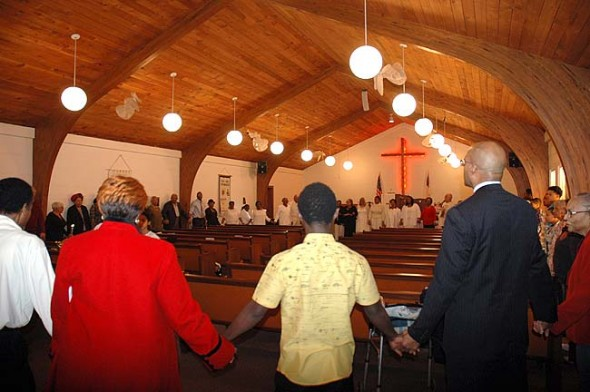 Worshippers at Central Chapel A.M.E. held hands and formed a circle around the perimeter of the church on a recent Sunday. The church is celebrating its 150th anniversary this year. All members of the Yellow Springs community are invited to anniversary events, including an anniversary worship service this Sunday, Feb. 14, at 11 a.m., featuring guest speaker Dr. Michael Brown of Payne Theological Seminary. (Photo by Audrey Hackett)