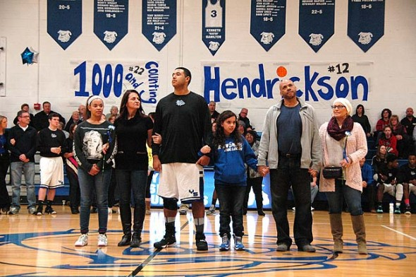 Senior Bulldog Isaiah Taylor stands with family members — from left: Alayna Wilson, Tanya Pahl, Isaiah Taylor, Sophie Clouse-Taylor, Michael Taylor, Lori Clouse — in the Yellow Springs High School gym as part of Senior Night, a cememony celebrating graduating athletes in every sport. Taylor is a starter on the basketball team and played — and won — one of the final games of his career immediately following the ceremony. (Photo by Dylan Taylor-Lehman)