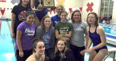 The Lady Bulldogs swam to glory at the Metro Buckeye Conference on Feb. 6, capturing the conference title and YSHS's first-ever win of the women's trophy. Pictured front row, left to right: Hannah Morrison and Elle Peifer. Middle row, left to right: Sara Zendlovitz, Olivia Chick, Jude Meekin, Amelia Gray and Charlotte Walkey. Back row, left to right: Olivia Brintlinger-Conn, Eden Spriggs (holding trophy) and Jorie Sieck. (Submitted Photo)