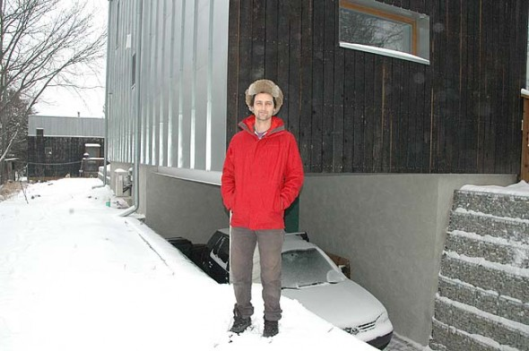 "Local residential designer Alex Melamed, above, who designed both a passive house and a tiny house on his Walnut Street lot, will be one of eight speakers at ""8x8 on Building Resiliency,"" this Saturday, Feb. 20, at 1 p.m. at the Antioch College arts and science building, room 219, part of a weekend of events aimed at enhancing resiliency of local buildings. The event will be followed by a documentary on the ""New Pedestrianism"" on Sunday, Feb. 21, at 1 p.m. at the Little Art and a home energy saving demonstration at 3 p.m. at the Yellow Springs Library. (Photo by Diane Chiddister)"