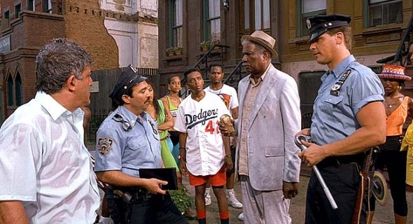 """""""Do the Right Thing,"""" an acclaimed 1989 film by director Spike Lee (center in Dodgers jersey), will be shown this Saturday, Feb. 20, at 11 a.m. at the Little Art Theatre. The film, which is free and open to the public, is part of the Black History Month film series sponsored by the 365 Group and Yellow Springs Young People of Color. (Still from Do the Right Thing)"""